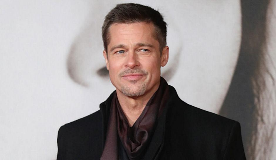 """O ator Brad Pitt em evento promocional de """"Aliados"""" (Foto: reprodução/The Enquirer)"""