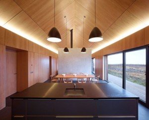 Beautiful-Open-Floor-Kitchen-and-Dining-Area-at-Borreraig-House-with-Light-Wood-Ceiling-Design-and-Modern-Pendant-Lamps