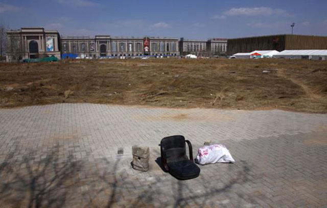 A chair lies on a deserted field that was once part of the stadium where the 2008 Olympic Games baseball competition was held in central Beijing