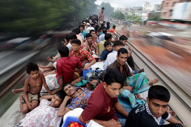 Passengers sit on top of an overcrowded train as it heads for Jamalpur from Dhaka.