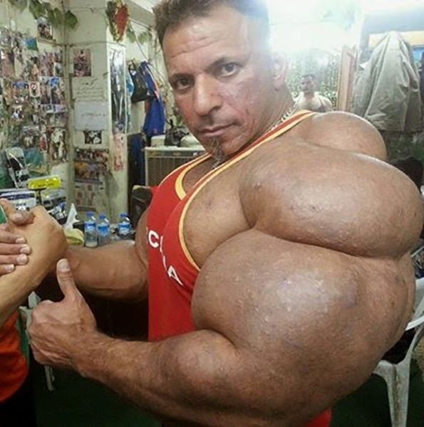 this_guy_has_the_most_gigantic_arm_muscles_ever_640_10